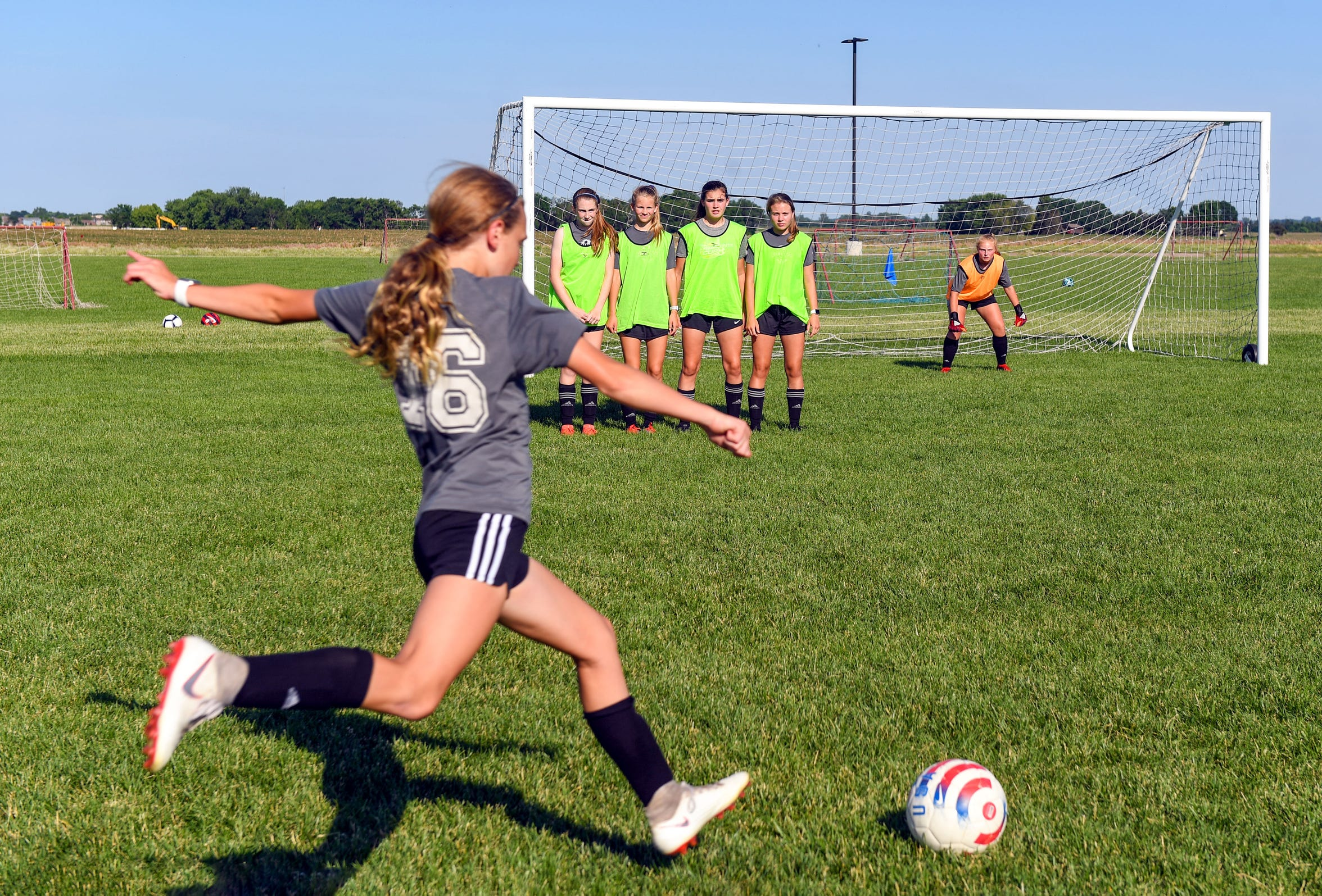 A player on the Dakota Alliance soccer team for girls ages 13-14 aims a kick toward the goal during practice Wednesday, June 26, at the Harrisburg Training Grounds.