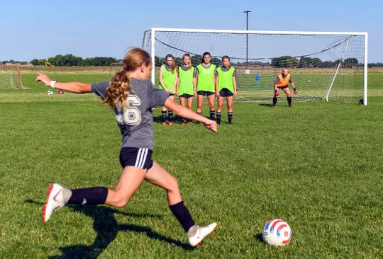 A player on the Dakota Alliance soccer team for girls ages 13-14 aims a kick toward the goal during practice last summer.