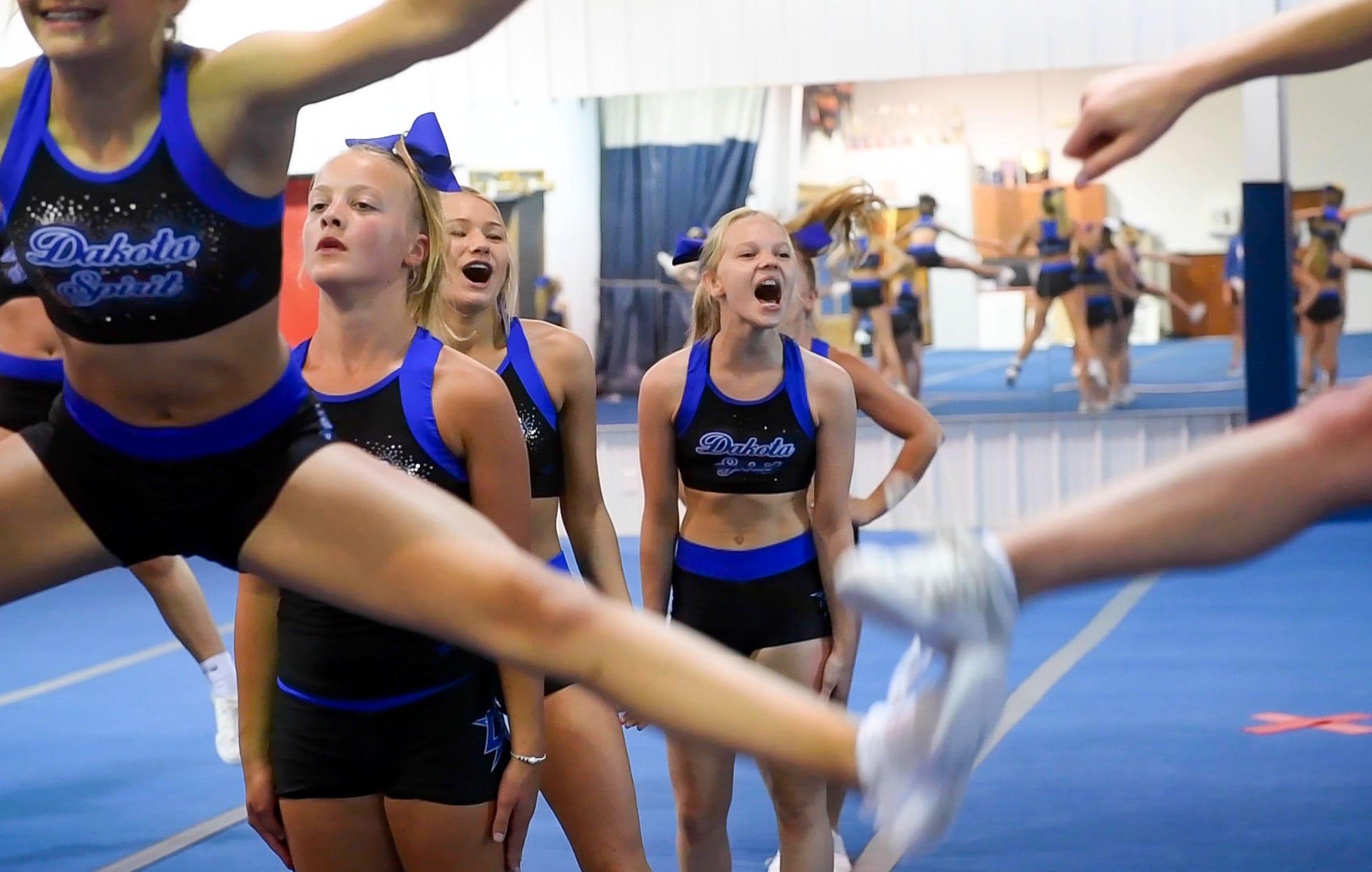 Dakota Spirit cheerleaders encourage their squad members during drills Thursday, June 27, in Sioux Falls.