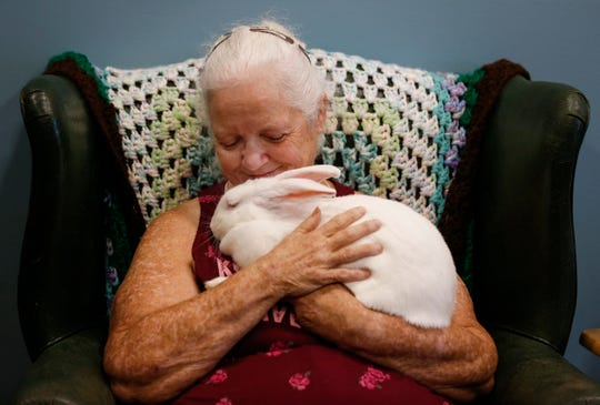 Marie Carr, 62, holds her emotional support rabbit Lacy at the Women's Medical Respite on Tuesday, July 2, 2019.