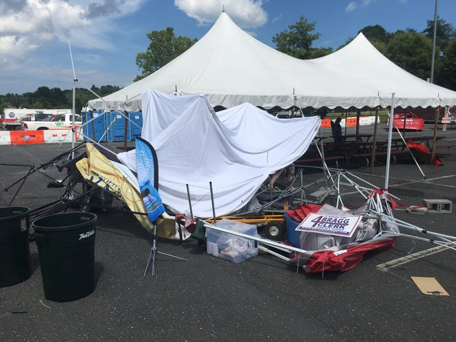 A weather disturbance lifted up several vendor tents at Gypsy Hill park near the football stadium on July 3, 2019.