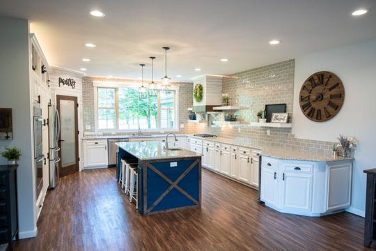 The gourmet kitchen is finished with granite countertops, stainless steel appliances and a large center island with a prep sink and under-counter seating.