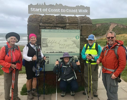 Our Crew at mile marker 0.0 of the Coast to Coast