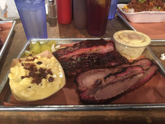 My plate of brisket, ribs, macaroni and cheese and banana pudding at the Pecan Lodge in Dallas, Texas.