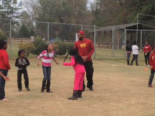 "Javorius ""Buck"" Allen plays football with kids January 2014  at the Boys & Girls Club in Miccosukee."