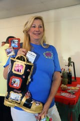 """Volunteer Sue Dannahower introduces the Gary Brooks Commemorative Boot at the """"Margaritaville"""" themed Lil Feet fundraiser in Fort Pierce."""