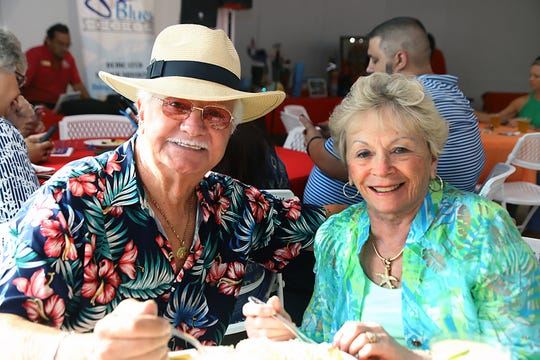 "Hank Miller and MaryAnn Campana at the ""Margaritaville"" themed Lil Feet fundraiser in Fort Pierce."