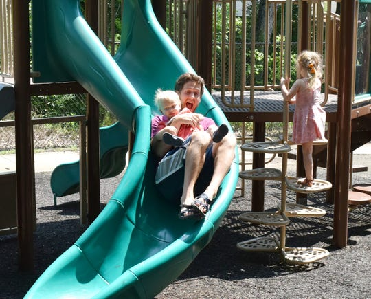 A family enjoys playing at Jaycee Park in Clemson.