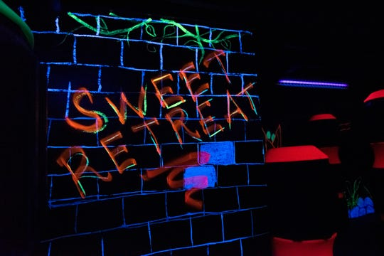 Inside the laser tag room at Sweet Retreat Fun Center.