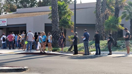 A long line forms outside the Thousand Oaks office of the state Department of Motor Vehicles in this file photo from summer 2018. The agency has come under intense criticism for long waits.