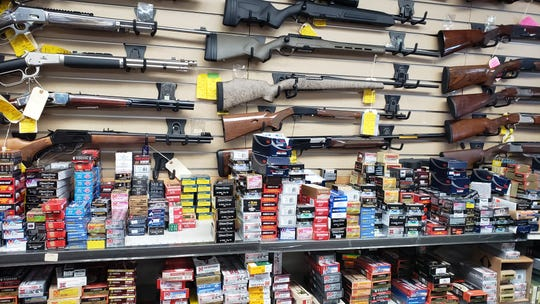 Firearms and ammunition are displayed for sale at the Camarillo Gun Store. One employee said the state communicated poorly when it came to rolling out a background check system for ammo buyers.