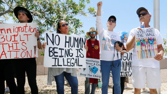 Protesters gather at the front of the Clint Border Patrol station to hear U.S. and Texas lawmakers talk about what they thought of the area facilities they toured Monday at the Border Patrol station in Clint, Texas.