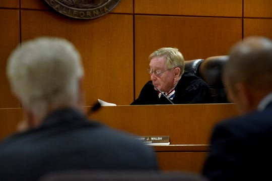 In this July photo, Ventura County Superior Court Judge Henry J. Walsh reads instructions to the jury as they prepare to decide punitive damages in the civil dispute between Sriracha sauce maker Huy Fong Foods and Underwood Ranches.