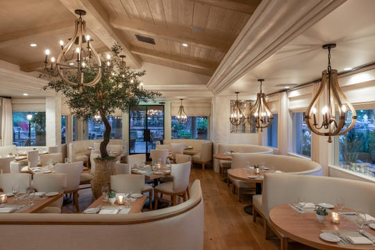 A potted tree is seen in the remodeled dining room of Mediterraneo at the Westlake Village Inn.