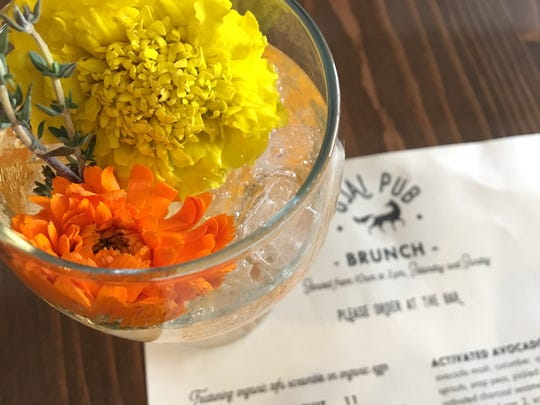 Weekend-brunch cocktails at Ojai Pub include the Superbloom Spritz, made with Pixie tangerine juice and garnished with a garden's worth of edible flowers.