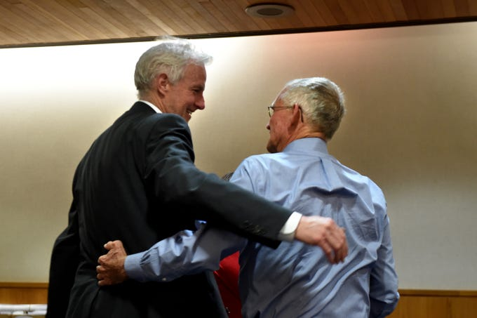 In this July photo, attorney Jim McDermott (left) congratulated Craig Underwood at the conclusion of the civil trial against Sriracha maker Huy Fong Foods.
