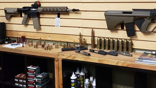 Various types of ammunition are lined up on a shelf at Knights Tactical, a gun store in Camarillo. The store stopped selling ammo for now while the owner learns the new background check system.