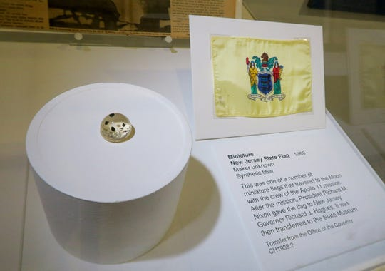 This miniature New Jersey State Flag traveled to the moon with Apollo 11 astronauts and is part of the exhibit on the 50th anniversary of the mission at the State Museum in Trenton Tuesday, July 2, 2019.