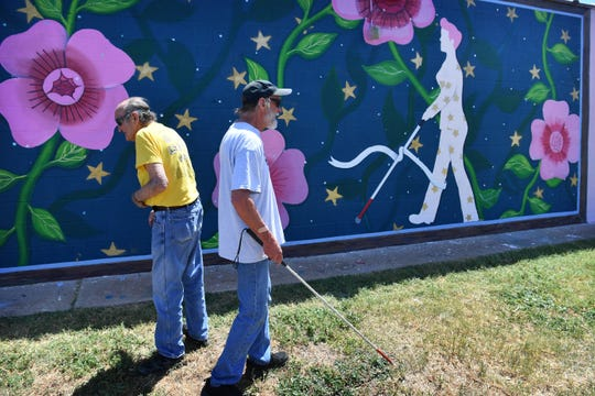 Bob White, left, and Kenny Reynolds check out part of the new mural at Beacon Lighthouse for the Blind Tuesday morning.