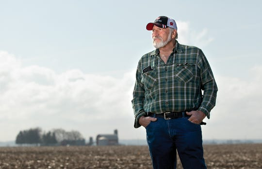 Mike Cerny is shown in a recently planted soybean field on his farm near Sharon, Wis., in early May 2019.