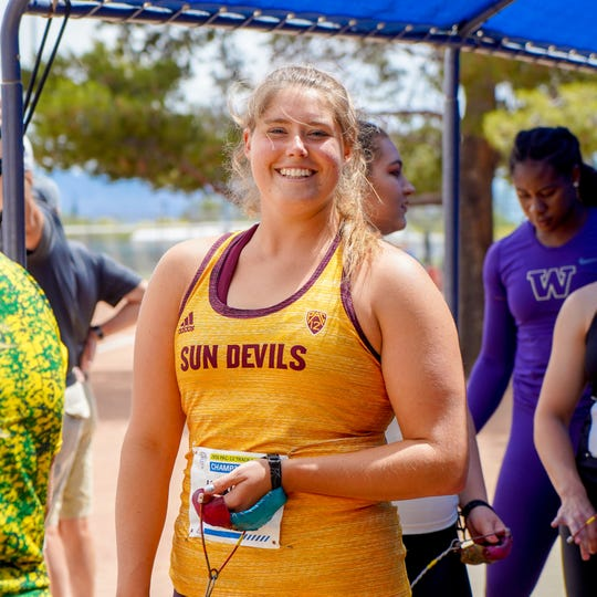 Tri-Valley grad Kaylee Antill poses for a photo following a meet for Arizona State. The former Tri-Valley state champion has battled sickness and injuries the past two seasons, but still has high hopes for a strong finish to her career.