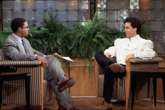 """Jerry (Jerry Seinfeld), right, became a fashion trailblazer – and not in a good way – when he wore the infamous Puffy Shirt during an appearance with Bryant Gumbel on """"Today"""" during an episode of """"Seinfeld."""""""