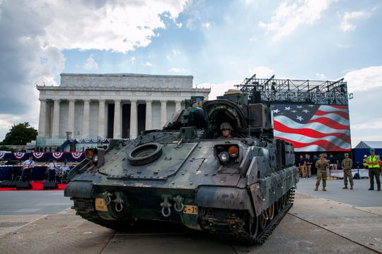 An Army driver with the 3rd Infantry Division, 1st Battalion, 64th Armored Regiment, drives a Bradley Fighting Vehicle into place by the Lincoln Memorial, Wednesday, July 3, 2019, in Washington, ahead of planned Fourth of July festivities with President Donald Trump. (AP Photo/Jacquelyn Martin) ORG XMIT: DCJM109