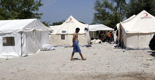 A refugee walks at a tent camp in Bihac, Bosnia and Herzegovina, in June 2019.