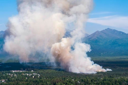 A brush fire burns in South Anchorage, Alaska, on July 2, 2019.