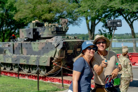 Marcia Fuentes De Arroba, and Ivan Arroba take a selfie with a Bradley Fighting Vehicles parked near the Lincoln Memorial in the background on July 3, 2019. Ivan is a United States Navy retiree and the couple is visiting Washington D.C. from Ecuador to celebrate their anniversary. The vehicle is here for Thursdays July Fourth Salute to America celebration.