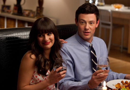 "Lea Michele and Cory Monteith in character on ""Glee."""