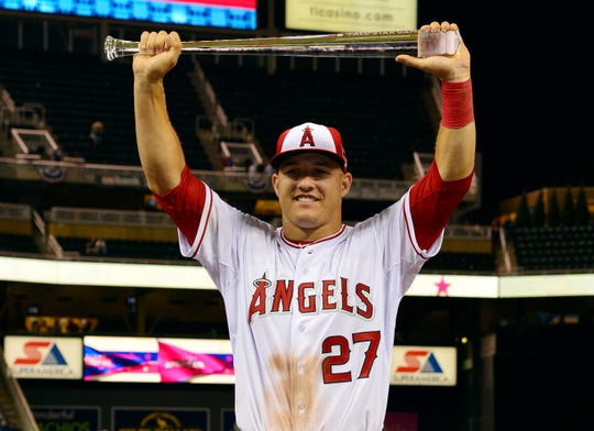 Mike Trout of the Los Angeles Angels holds up the MVP trophy after after the 2014 MLB All Star Game at Target Field.