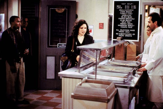 """Elaine (Julia Louis-Dreyfus) messes with the Soup Nazi (Larry Thomas) and you know what that means: """"No soup for you!"""""""