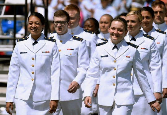 In this May 22, 2019 file photo, future United State Coast Guard graduates arrive at the commencement ceremony in New London, Conn.
