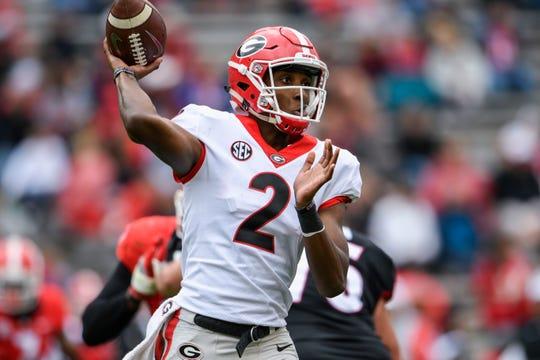 Georgia Bulldogs quarterback D'Wan Mathis (2) passes during the Georgia spring game at Sanford Stadium.