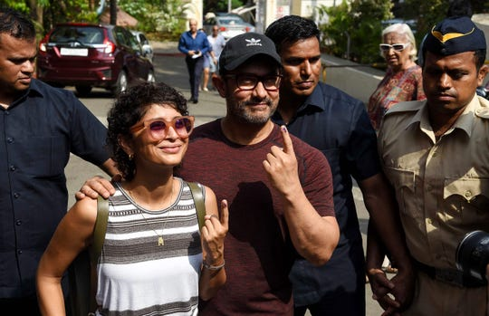 """Indian Bollywood actor Aamir Khan (shown voting in April parliamentary elections with his wife, producer Kiran Rao) is making his own version of """"Forrest Gump."""""""