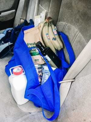Reusable shopping bag with groceries in reusable or recyclable containers.