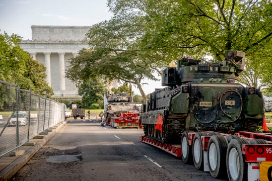 Two Bradley Fighting Vehicles are parked nearby the Lincoln Memorial for President Donald Trump's 'Salute to America' event honoring service branches on Independence Day.