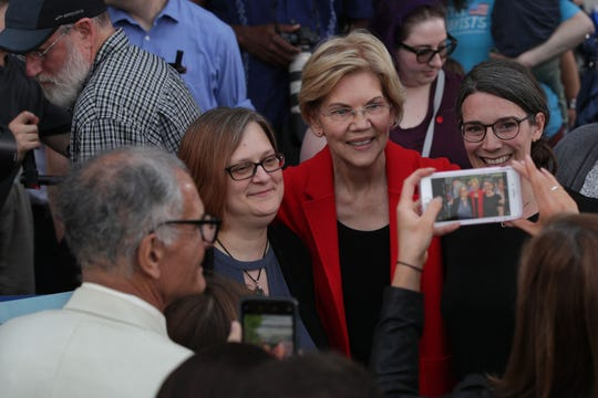 Democratic U.S. presidential hopeful Sen. Elizabeth Warren (D-MA) poses for selfies with voters after a campaign town hall at George Mason University May 16, 2019 in Fairfax, Virginia. Sen. Warren held a town hall to tell her plans for Americans and answer questions from voters.