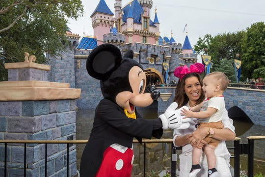 Eva Longoria and her son Santiago Enrique Baston celebrate his first birthday at Disneyland in California.