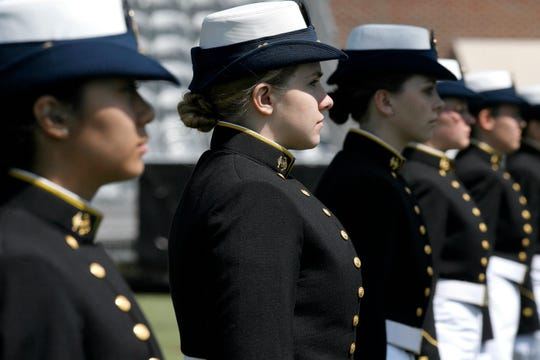 In this May 22, 2019 file photo, female cadets at the United States Coast Guard Academy line up during commencement in New London, Conn.
