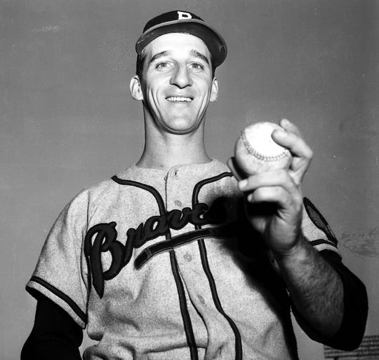 Warren Spahn, U.S. Army: The left-hander joined the Army in 1942, his rookie season with the Boston Braves.Hefought in World War II's Battle of the Bulge and saw combat at the Ludendorff Bridge, where his unit was under constant enemy fire. Spahn's foot was injured by shrapnel, and he received a Purple Heart as well as a battlefield commission as a second lieutenant. He returned to baseball after being discharged in 1946.
