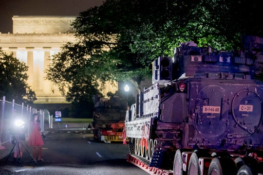 "Two Bradley Fighting Vehicles are parked next to the Lincoln Memorial before President Donald Trump's ""Salute to America,"" event honoring service branches on Independence Day."
