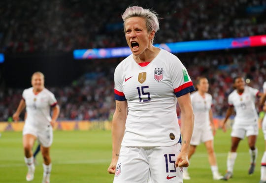 Megan Rapinoe celebrates after scoring a goal against France.