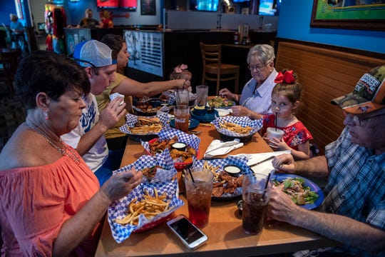 "A family visiting Blue Moose Burgers and Wings in Pigeon Forge digs into some of the restaurant's featured items. Blue Moose's theme is familiar – a sports bar with burgers, wings and craft beer. But it's the customer service that many say separates this non-chain from its competitors. ""Tourists want to let their belt out, and they want to eat,"" says managing partner Scott MacDonald. ""If you're on vacation you want to splurge."""