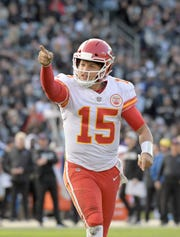 Kansas City Chiefs quarterback Patrick Mahomes (15) celebrates in the third quarter against the Oakland Raiders at Oakland-Alameda County Coliseum.