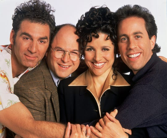 """The """"Seinfeld"""" gang - Kramer (Michael Richards), left, George Costanza (Jason Alexander), Elaine Benes (Julia Louis-Dreyfus) and Jerry Seinfeld (Seinfeld playing a version of himself) - still entertain TV viewers 30 years after the hit sitcom's premiere."""