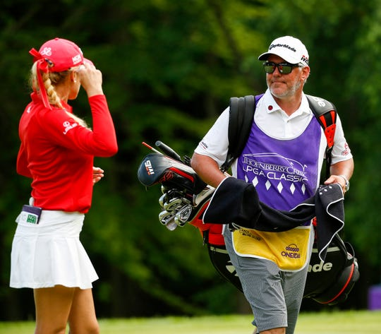 Mark Champion of Green Bay talks with golfer Natalie Gulbis during the Thornberry Creek LPGA Classic on Thursday in Hobart.