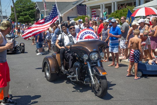 The American Legion Motorcycle Club rides into the ceremony. Annual Fourth of July flag raising at Rob Mruzek's home on the Toms River side of Normandy Beach. The event features the Black Sheep Squadron fly over, the American Legion Motorcycle Club, and the Shamrock and Thistle Pipe and Drums  and nowadays, more than 1,000 attendees.