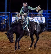 Canyon Conley of LaDonia holds on during the ranch bronc competition at Wednesday's Texas Cowboy Reunion in Stamford.